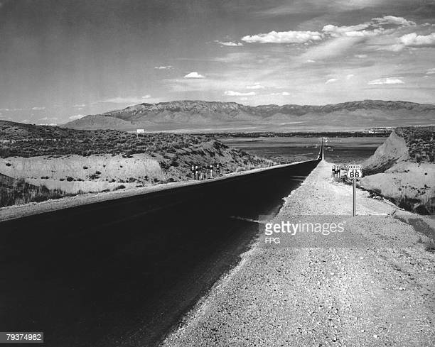 US Route 66 leading towards Albuquerque with the Sandia Mountains in the background circa 1940