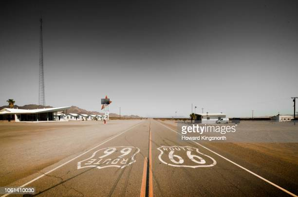 route 66 road signage on highway - amboy california stock photos and pictures