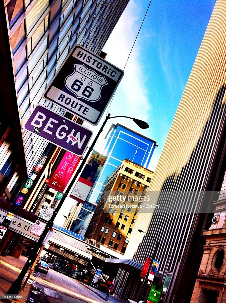 Route 66 sign in city : Stock Photo