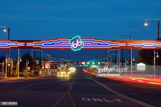 route 66 sign on central avenue in albuquerque at night - rainer grosskopf stock pictures, royalty-free photos & images