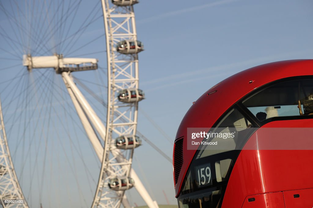 A Routemaster bus drives past the Coca-Cola London Eye in Westminster on January 5, 2017 in London, England. TFL, Transport for London has confirmed it will 'discontinue' purchases of the new green Routemaster buses.