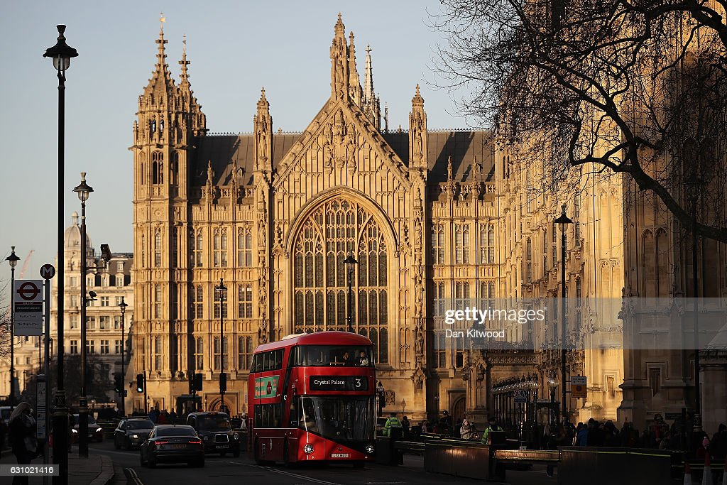 A Routemaster bus drives past the Houses of Parliament in Westminster on January 5, 2017 in London, England. TFL, Transport for London has confirmed it will 'discontinue' purchases of the new green Routemaster buses.