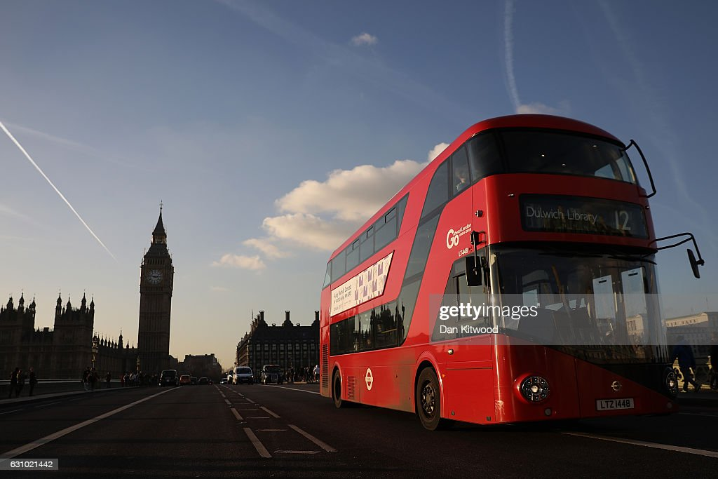 A Routemaster bus drives past the Houses of Parliament in Westminster towards Dulwich Library on January 5, 2017 in London, England. TFL, Transport for London has confirmed it will 'discontinue' purchases of the new green Routemaster buses.