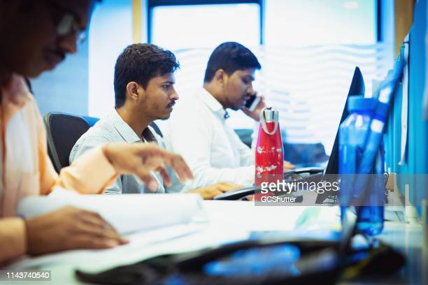 routine cubical grind at a busy office - wages stock pictures, royalty-free photos & images