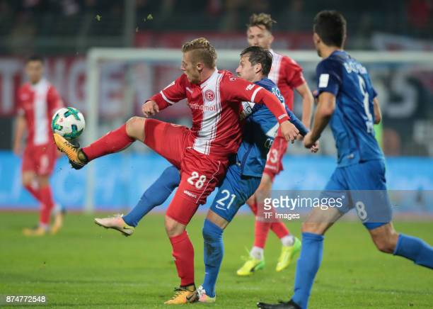 Rouven Hennings of Duesseldorf and Stefano Celozzi of Bochum battle for the ball during the Second Bundesliga match between VfL Bochum 1848 and...