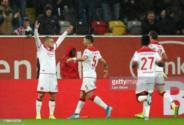 Rouwen Hennings celebrates after he scores his sides first goal during the Bundesliga match between Fortuna Duesseldorf and 1. FC Union Berlin at...
