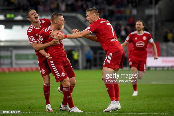 Rouwen Hennings celebrates with his teammates after scoring his team's first goal during the Second Bundesliga match between Fortuna Düsseldorf and...