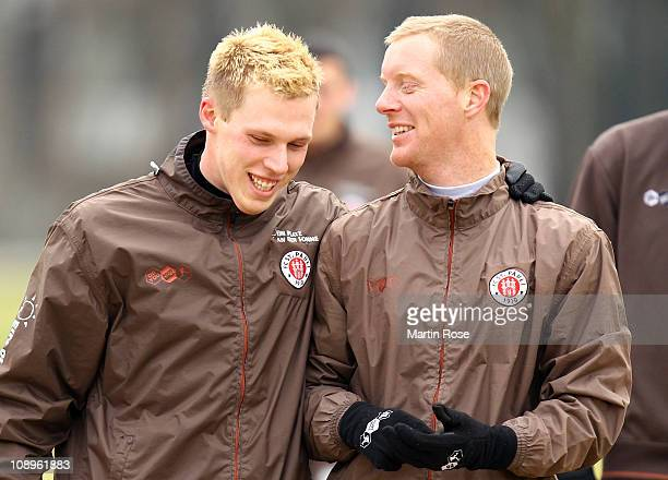 Rouwen Hennings jokes with team mate Marius Ebbers after a training session on February 10 2011 in Hamburg Germany