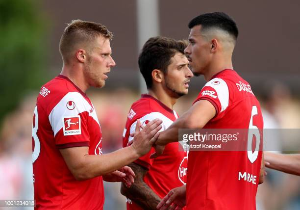 Rouwen Hennings of Duesseldorf celebrates the forth goal with Alfredo Morales of Duesseldorf during the Pre Season Friendly match between FC...