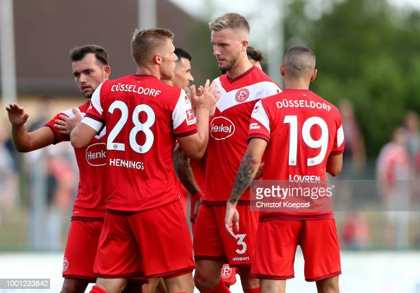 Rouwen Hennings of Duesseldorf celebrates the forth goal with Andre Hoffmann of Duesseldorf during the Pre Season Friendly match between FC...