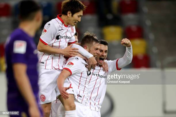 Rouwen Hennings of Duesseldorf celebrates the second goal with Genki Haraguchi of Duesseldorf and Davor Lovren of Duesseldorf during the Second...