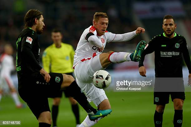 Rouwen hennings of Duesseldorf challenges Stefan Strandberg of Hannover during the Second Bundesliga match between Fortuna Duesseldorf and Hannover...