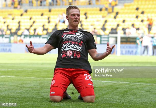 Rouwen Hennings of Duesseldorf jubilates after moving up into the Bundesliga after the Second Bundesliga match between SG Dynamo Dresden and Fortuna...