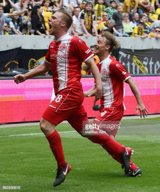 Rouwen Hennings of Duesseldorf jubilates after scoring the third goal and moves into the Bundesliga during the Second Bundesliga match between SG...