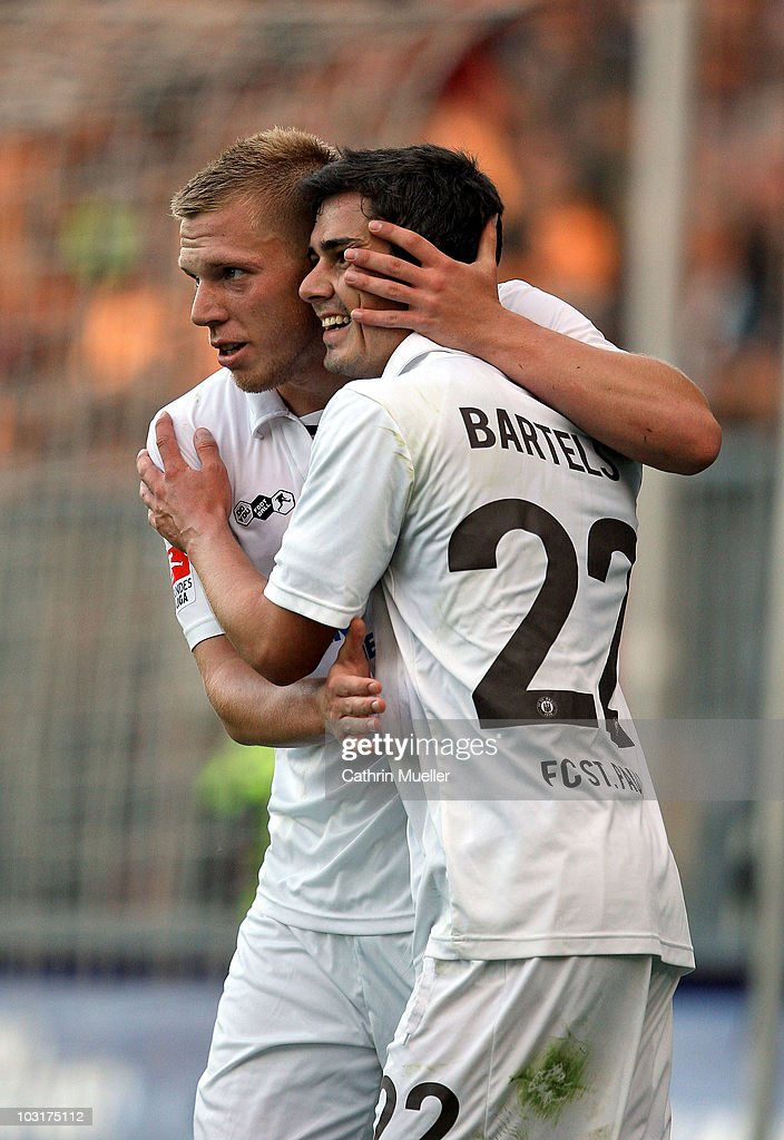 Rouwen Hennings (L) of FC St. Pauli celebrates his goal with teammate Fin Bartels during the pre-season friendly match aginst Racing Santander at Millerntor Stadium on July 30, 2010 in Hamburg, Germany.