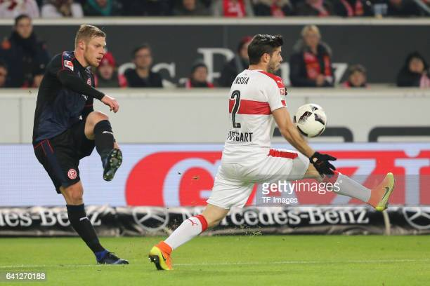 Rouwen Hennings of Fortuna Duesseldorf and Emiliano Adrian Insua Zapata of Stuttgart battle for the ball during the Second Bundesliga match between...