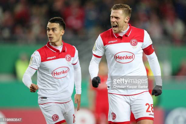 Rouwen Hennings of Fortuna Duesseldorf celebrates after scoring his team`s second goal during the DFB Cup round of sixteen match between 1. FC...