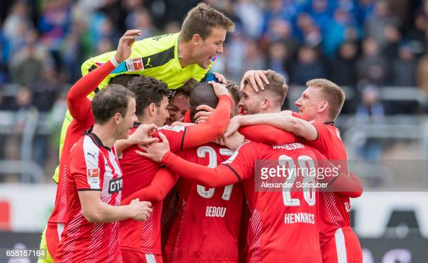 Rouwen Hennings of Fortuna Duesseldorf celebrates the third goal for his team with his teammates during the Second Bundesliga match between...
