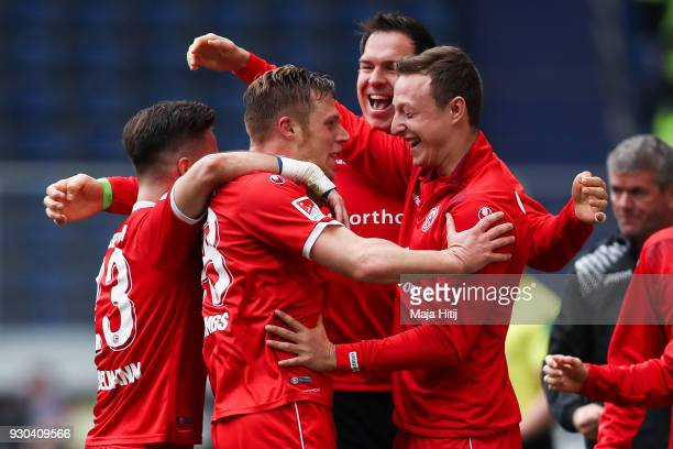 Rouwen Hennings of Fortuna Duesseldorf celebrates with his teammates after scoring his teams first goal to make it 01 during the Second Bundesliga...