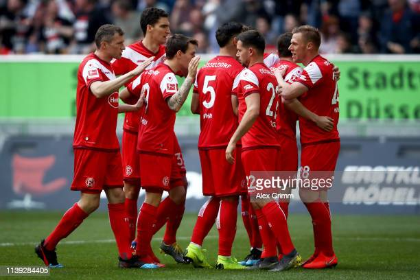 Rouwen Hennings of Fortuna Duesseldorf celebrates with teammates after scoring his team's first goal during the Bundesliga match between Fortuna...
