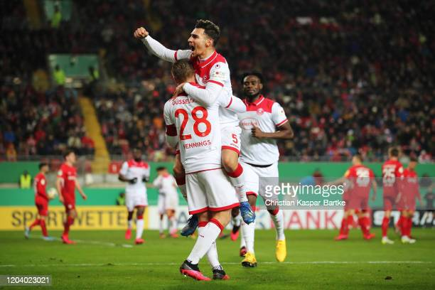 Rouwen Hennings of Fortuna Dusseldorf celebrates with Kaan Ayhan after scoring his team's fourth goal celebrates after scoring his team's fourth goal...