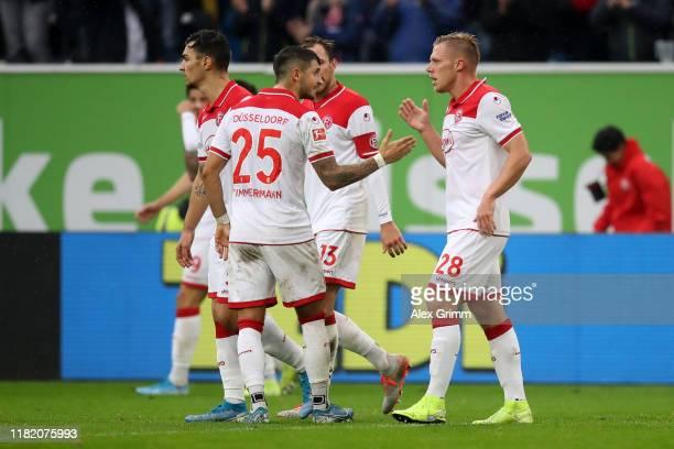 Rouwen Hennings of Fortuna Dusseldorf celebrates with teammate Matthias Zimmermann after scoring his team's first goal during the Bundesliga match...