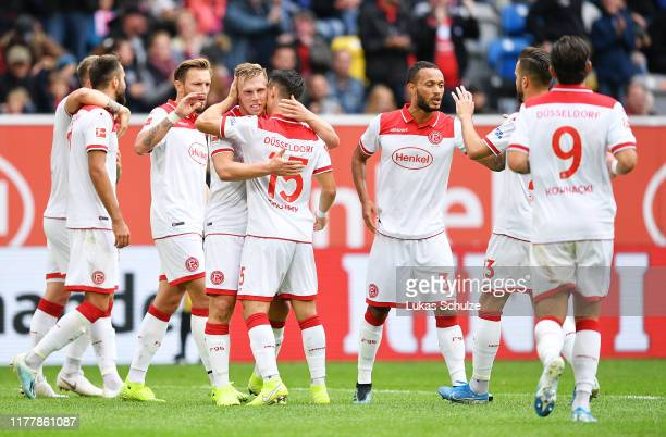 Rouwen Hennings of Fortuna Dusseldorf celebrates with teammates after scoring his team's first goal during the Bundesliga match between Fortuna...