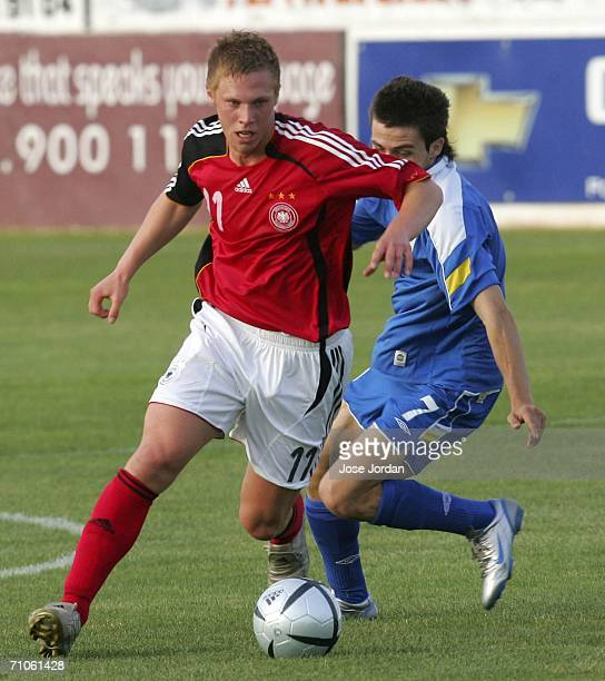 Rouwen Hennings of Germany vies for the ball with Aandreas Papanastasiou of Cyprus during the UEFA Under 19 qualification round between Germany and...