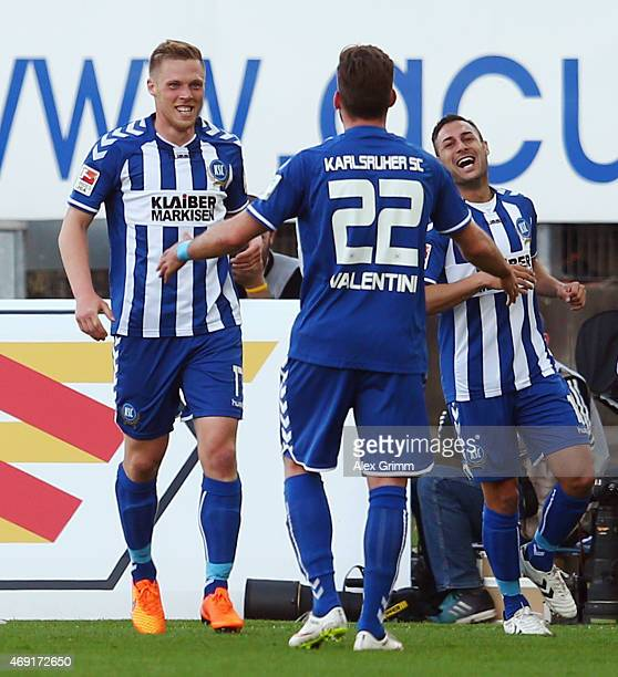 Rouwen Hennings of Karlsruhe celebrates his team's second goal with team mates Enrico Valentini and Dimitrij Nazarov during the Second Bundesliga...