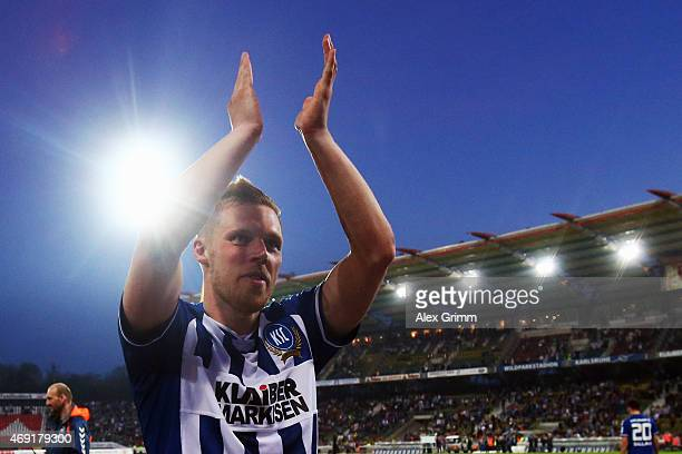 Rouwen Hennings of Karlsruhe celebrates with the fans after the Second Bundesliga match between Karlsruher SC and FC St Pauli at Wildpark Stadium on...