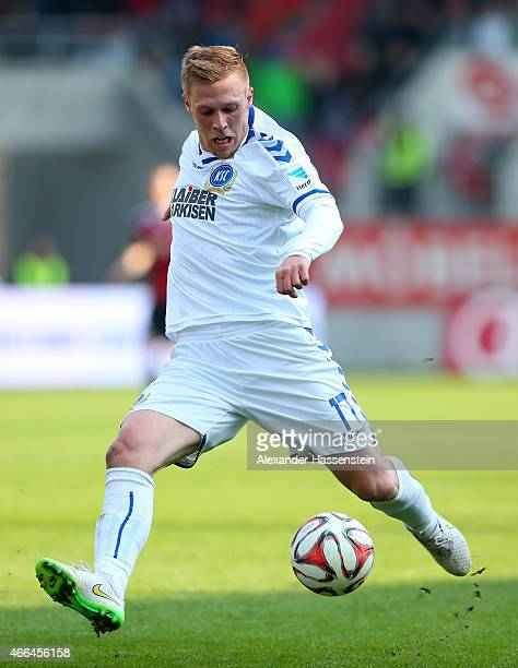 Rouwen Hennings of Karlsruhe runs with the ball during the Second Bundesliga match between FC Ingolstadt and Karlsruher SC at Audi Sportpark on March...