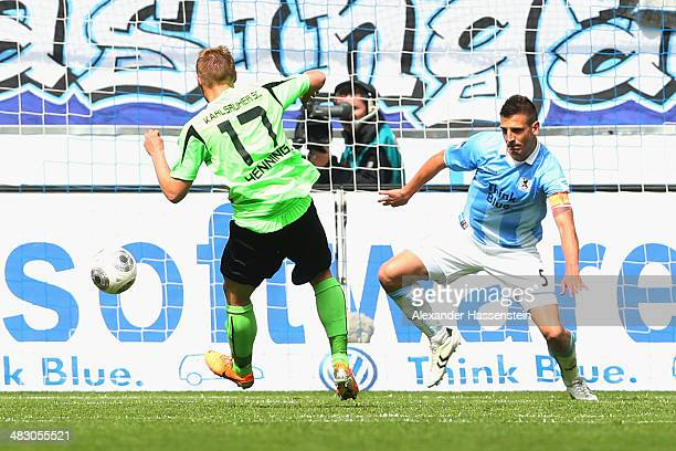 Rouwen Hennings of Karlsruhe scores the 2nd team goal against Guillermo Vallori of Muenchen during the Second Bundesliga League match between 1860...