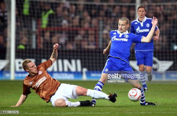 Rouwen Hennings of St Pauli and Peer Kluge of Schalke battle for the ball during the Bundesliga match between FC St Pauli and FC Schalke 04 at...