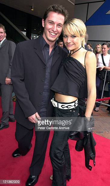 Rove McManus and Belinda Emmett arrive for the 14th Annual ARIA Awards at the Sydney Entertainment Centre on October 24 2000 in Sydney Australia