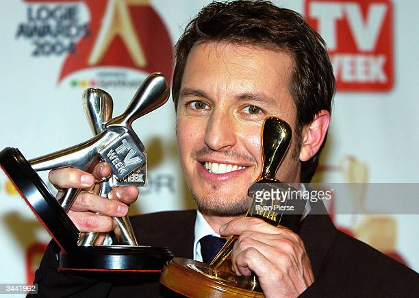 Rove McManus poses with his Gold Logie and two Silver Logies at the 46th Annual TV Week Logie Awards at the Crown Entertainment Complex April 18 2004...