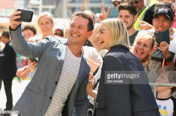 Rove McManus takes a selfie with Margot Robbie during the Peter Rabbit Australian Premiere on March 17 2018 in Sydney Australia