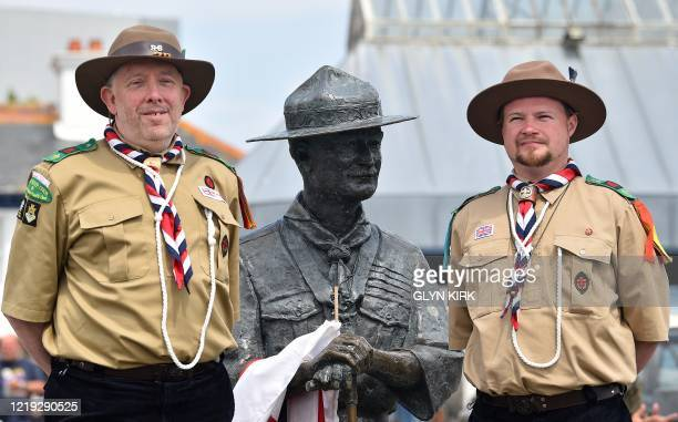 Rover Scouts Chris Arthur and Matthew Trott, pose with a statue of Robert Baden-Powell, the founder of the Scout movement, on the quayside in...