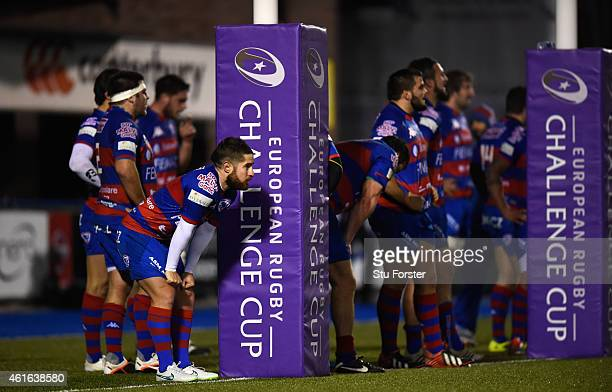 Rovigo scrum half Marco Frati and team mates look on after conceeding 50 points in the first half during the European Rugby Challenge Cup match...
