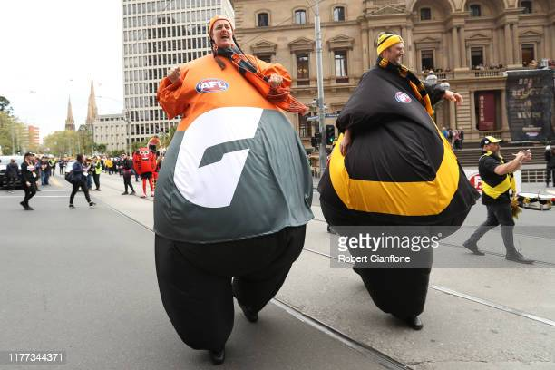 Roving entertainers take part in the 2019 AFL Grand Final Parade on September 27 2019 in Melbourne Australia