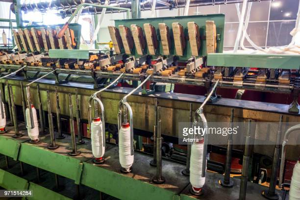 Roving frame machine for drafting the sliver into roving by twisting fibers in cotton mill / Carding machine that disentangles cleans and intermixes...