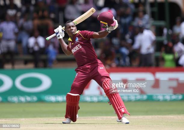Rovman Powell of The West Indies celebrates his century during The ICC Cricket World Cup Qualifier between The West Indies and Ireland at The Harare...