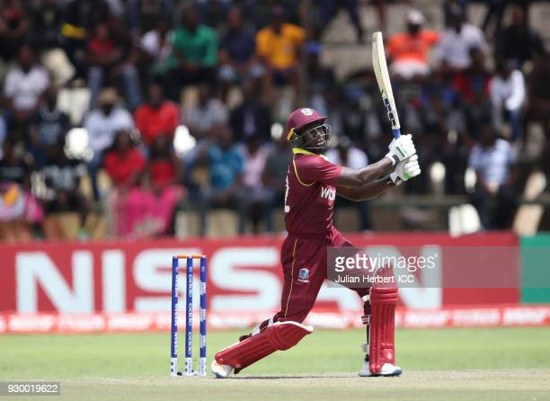 Rovman Powell of The West Indies hits out during The ICC Cricket World Cup Qualifier between The West Indies and Ireland at The Harare Sports Club on...