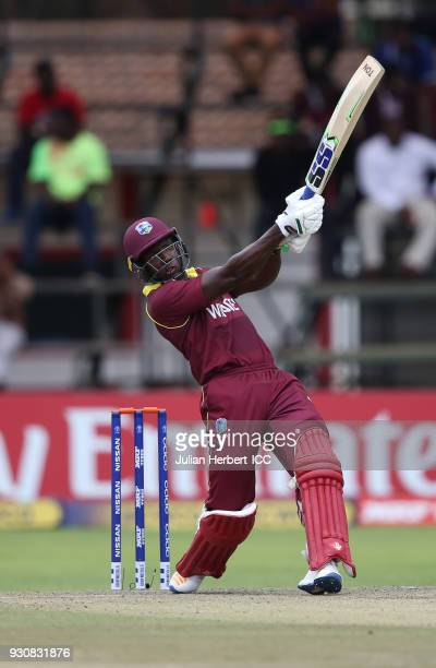 Rovman Powell of The West Indies scores runs during The ICC Cricket World Cup Qualifier between The West Indies and The Netherlands at The Harare...