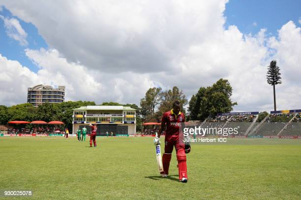 Rovman Powell of The West Indies walks off after his dismissal during The ICC Cricket World Cup Qualifier between The West Indies and Ireland at The...