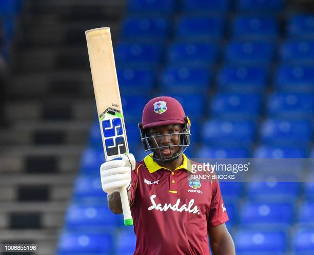 Rovman Powell of West Indies celebrates his half century during the 3rd and final ODI match between West Indies and Bangladesh at Warner Park...