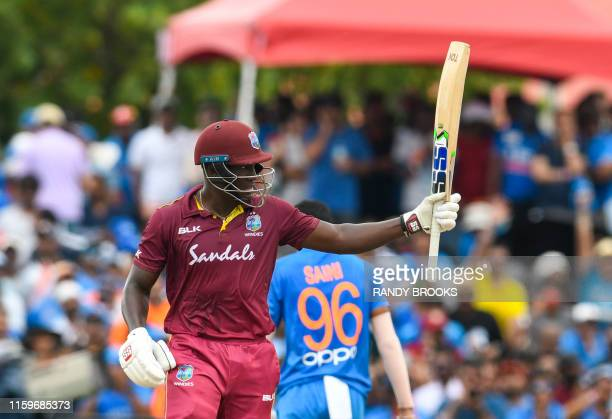 Rovman Powell of West Indies celebrates his half century during the 2nd T20i match between West Indies and India at Central Broward Regional Park...
