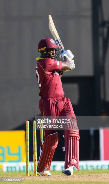 Rovman Powell of West Indies hits 4 during the 2nd ODI match between West Indies and Bangladesh at Guyana National Stadium Providence Guyana on July...