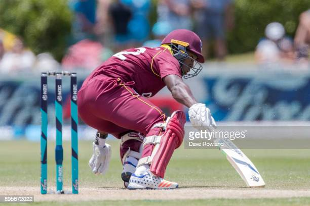 Rovman Powell of West Indies makes a run during the first match in the One Day International series between New Zealand and the West Indies at Cobham...