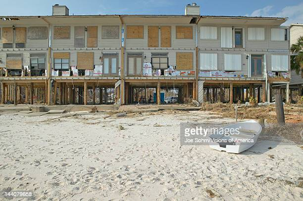 Row boat and waterfront house hit heavily by Hurricane Ivan in Pensacola Florida