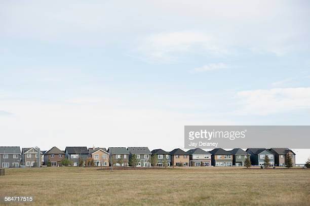row houses against cloudy sky - terraced_house stock pictures, royalty-free photos & images